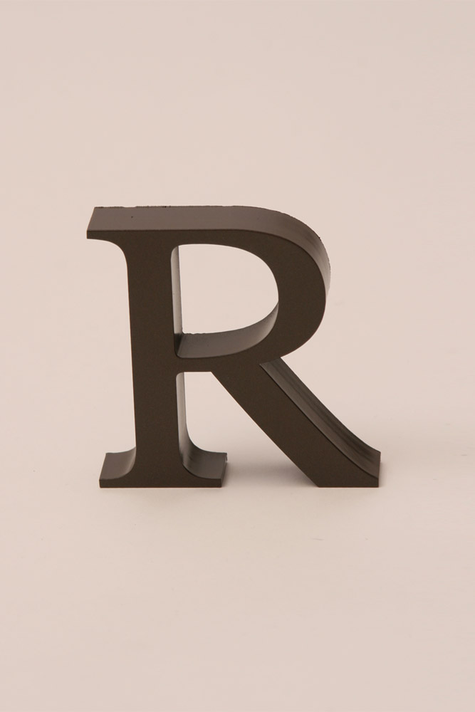 the sign collaborative With cast metal letters